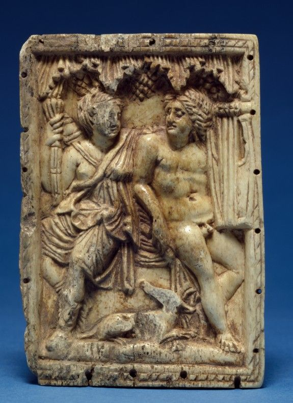 An ivory and bone ancient Roman plaque depicting Artemis and Apollo with symbolic attributes, a quiver and torch (Artemis) and a kithera and plectrum (Apollo). (Walters Art Museum)