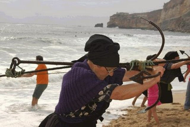 Fishing on the beach of Nazaré ,Portugal Tradition is fading away with time,but photos like this one will endure. Thank you for showing  and share.