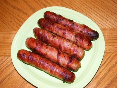Bacon Wrapped Hot Dogs - This can be done in a frying pan, baked in oven or grilled! 8 beef hot dogs 8 slices raw bacon colby jack cheese 8 hot dog buns Cut a slit down the center of each hotdog not cutting through. Put long thin slice of cheese in center of dog. wrap with a slice of raw bacon from one end to the other. place a toothpick at either end to secure bacon. Grill each side of bacon until browned.