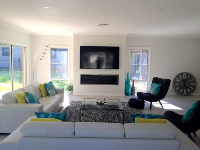 One of our customers, Julie, has shared a photo of the living space in her Bronte Farmhouse Grande Manor, complete with fireplace for year-round comfort. Her home is styled with a neutral backdrop and splashes of peacock blue and citrine yellow. For details on this design see http://mcdonaldjoneshomes.com.au/home-designs/new-south-wales-and-queensland/bronte/floorplans. #living #fireplace #tv #colour #neutral #neutralbackdrop #citrine #peacock #blue #yellow #acreage #farmhouse #bronte…