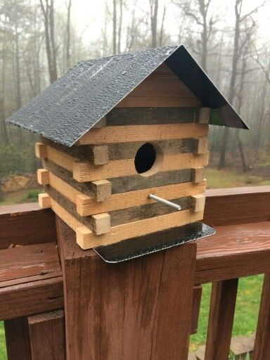 Bird house made from pallets and scrap metal.