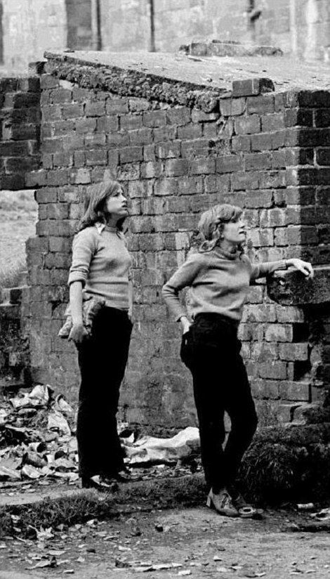 Searching for a better life: A pair of teenage girls can be seen in a Maryhill back court...
