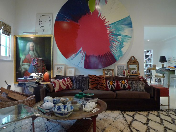 Hartig's eclectic living room features a Damien Hirst spin painting