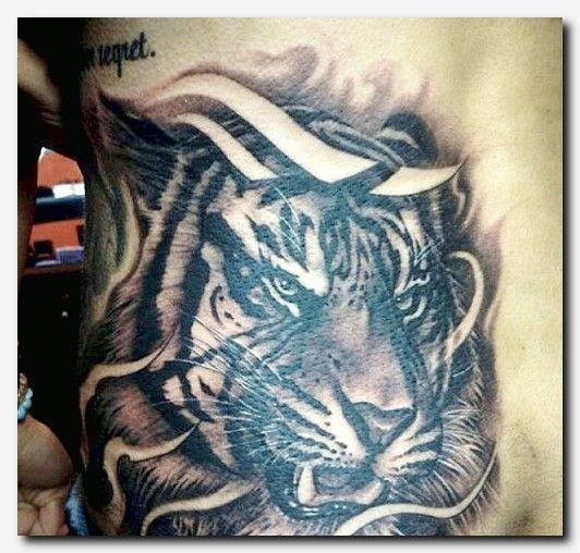 e56e5ce810d10 #tigertattoo #tattoo black bird tattoo meaning, kiss tattoo on neck,  egyptian tattoo