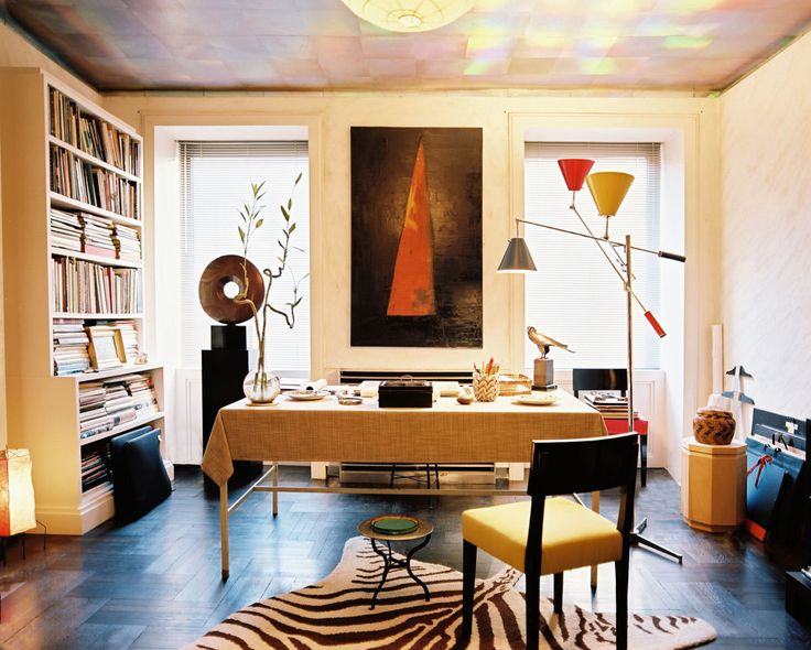 Albert Hadley's effortless style is evident throughout his New York City apartment, especially in the designer's home office complimented by modern art and contemporary accents.