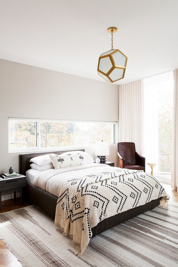 layers of neutral textiles + brass lighting // bedroom: