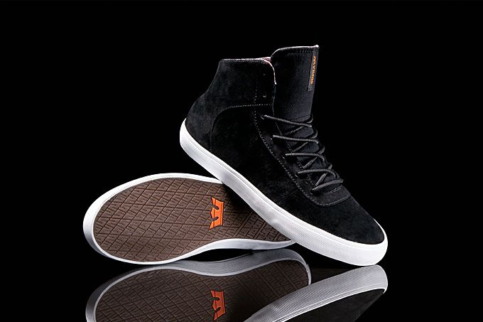 The U-throat eye stay construction and simple paneling of the Cuttler allows for ample expanses of the premium black pig suede in this Tropez pack mid top.