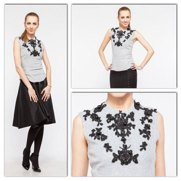 Grey Fleece Top with Black Handmade Lace Embroidery  and black 60' full skirt. The look is paired with beautiful black stilettos for a relaxed look. The available size in our Showroom is 36 European.