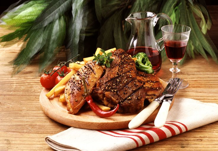 Hungarian mixed grille on a wooden platter, a favourite in many restaurants. Click for more ...