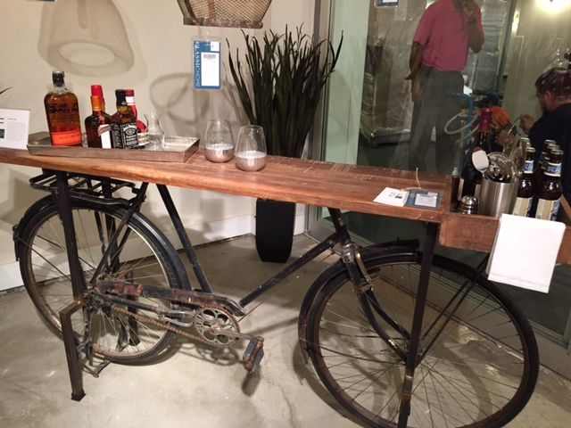 Check out this cool bicycle bar that Deb found at the April Furniture Show! This fun bike bar will be coming to #RegalHouse in June 2017!  #furniture #bar #bicycle #biking