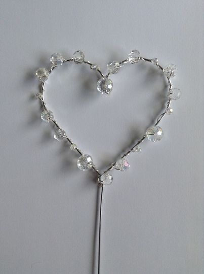 Great DIY project for your wedding. Beautiful silver heart wedding cake topper with crystal beads. Easy to make. Great gift idea. Made with copper wire.