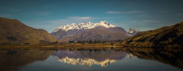https://flic.kr/p/Av46jE | Lake Hayes | A panorama of 8 shots taken on my 85mm at f/11, 1/400 and 100 ISO, stitched in Microsoft ICE.  Lake Hayes is known for it's still waters that are surrounded by mountains which makes it ideal for seeing reflections! It would have been nicer to get this same shot later on in the day closer to sunset as it looks a bit flat in this mid-day sun but it doesn't look too bad, will just have to go back there and try again!  www.facebook.com/TomHallPhoto/