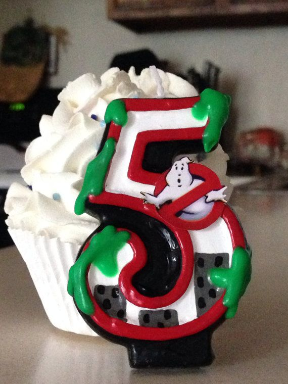 3 inch tall  'slimed' Ghostbusters inspired candle - any number  on Etsy, $10.00
