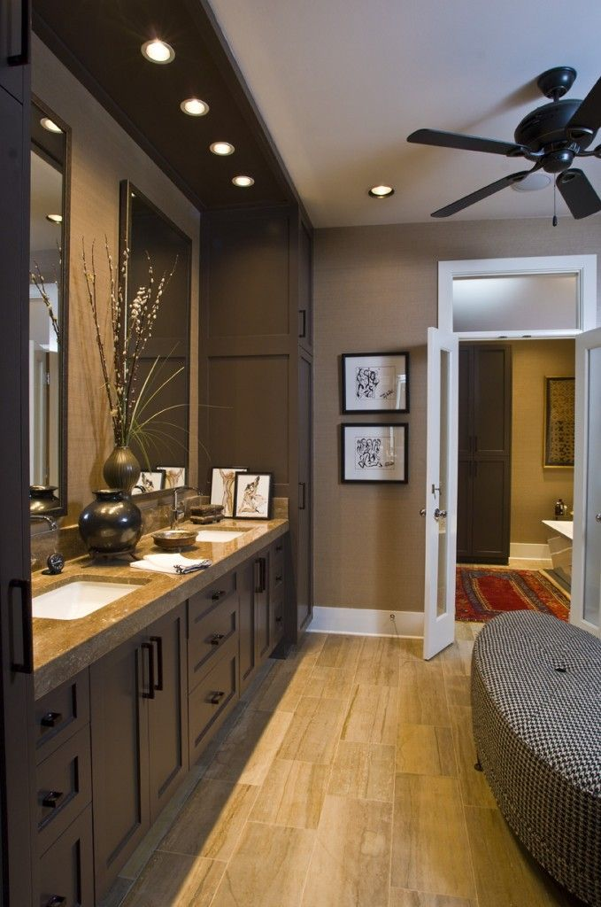 Pot lighting above and tall cabinets on sides.