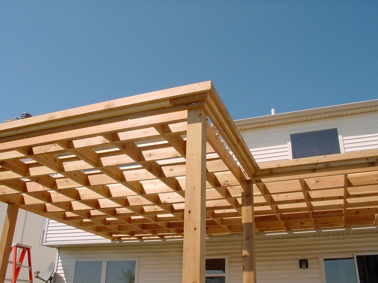 Contemporary cedar pergola without joist overhang by