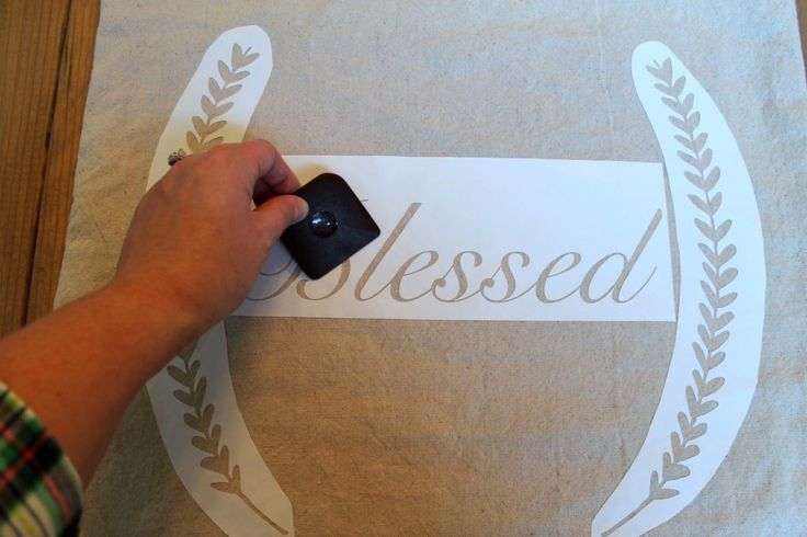 DIY Stenciled Drop Cloth Pillow Cover with link on how to convert png file to silhouette