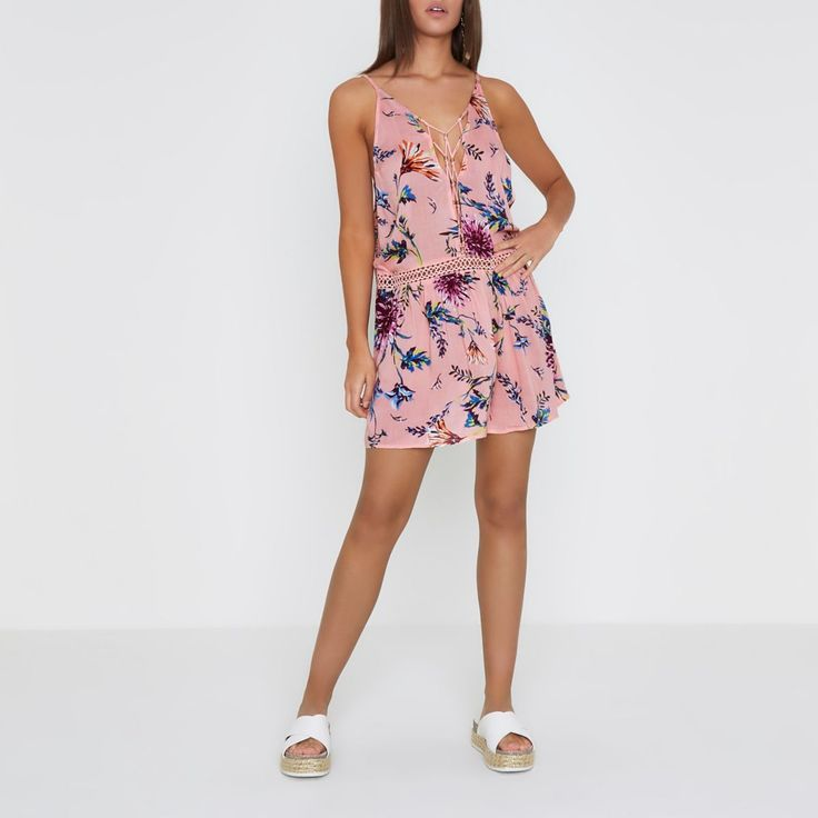 Woven fabric Floral print Gold tone bead and lattice neck detail Crochet trim waist Adjustable cami shoulder straps Low scoop back Mini length Beach cover up Our model wears a UK S and is 175cm/5'9'' tall