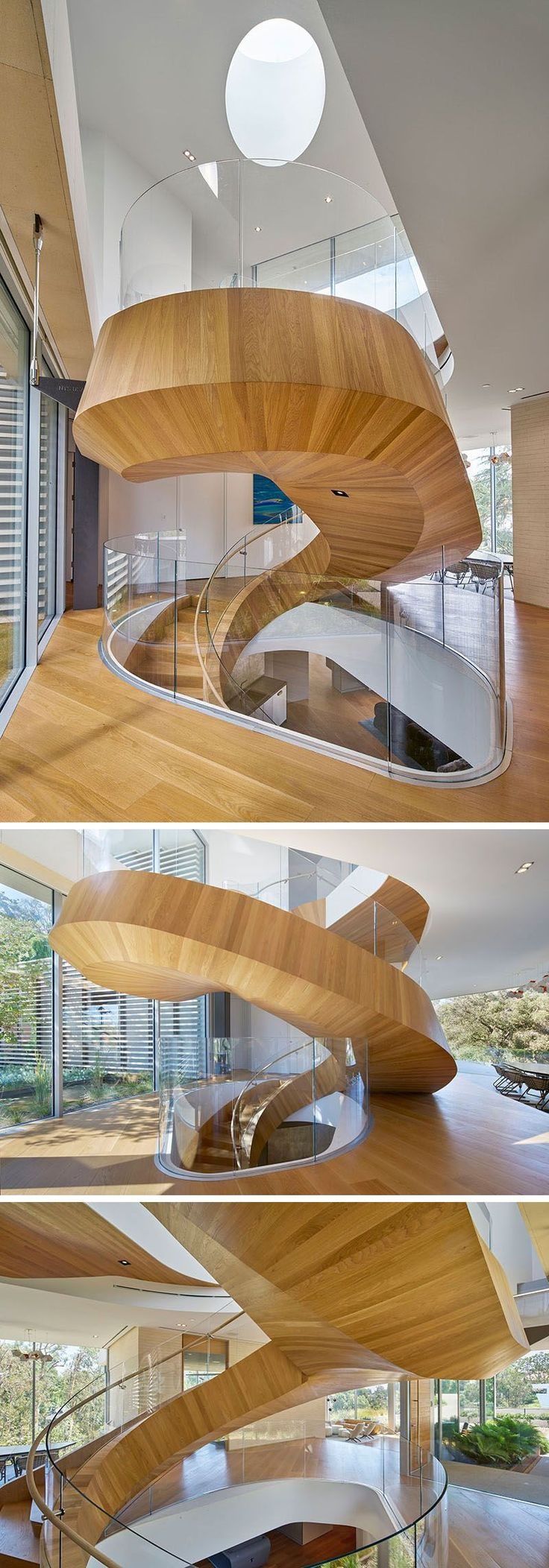 This large wood and spiral staircase not only connects various levels of the home but also divides the space and acts as a sculptural installation.