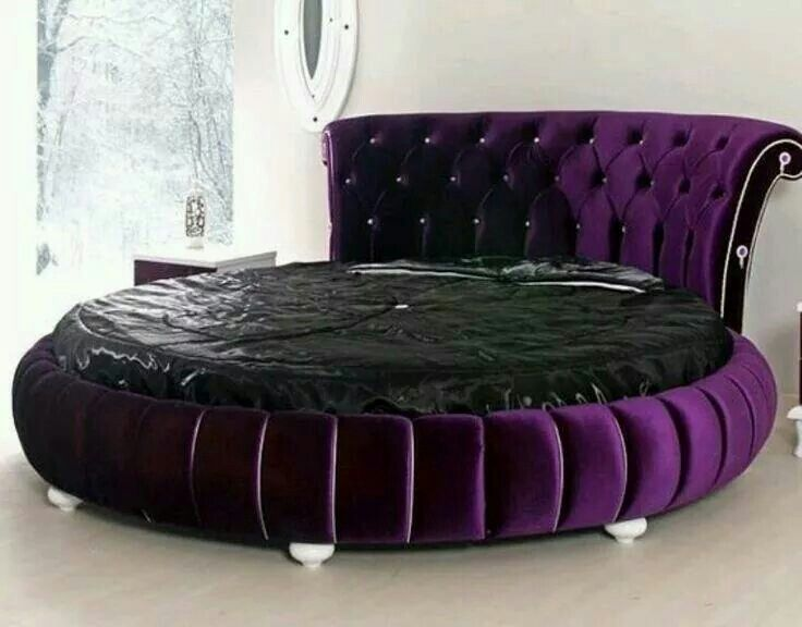 That velvet purple bed is gorgeous!!! I love it!!! I don't care for the black bedding. I guess they wanted to show the entire bed.  I want it.
