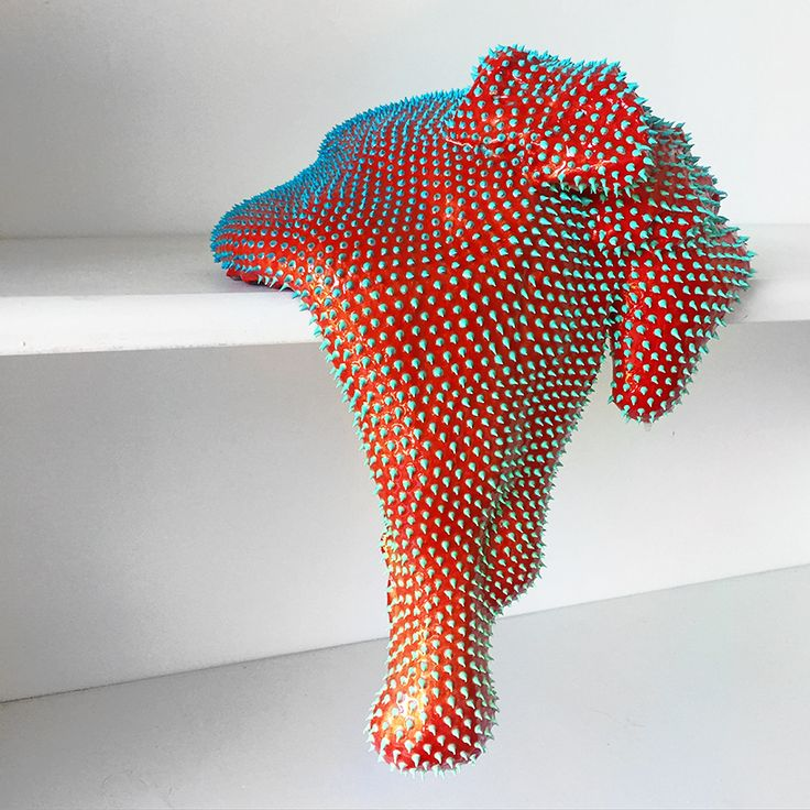 dan lam's drippy sculptures ooze a curvaceous anatomy of spikey neon matter. artist dan lam has formed a series of vibrant, free-standing 'drippy sculptures' that resemble exotic organic matter seemingly sourced from another planet. the neon-hued artworks form elongated, stretched shapes that ooze off the edges of surfaces. the sculptural blobs are covered in skin of hard spikes — gradating in color and size — that wrap around the curvaceous anatomy of each object.