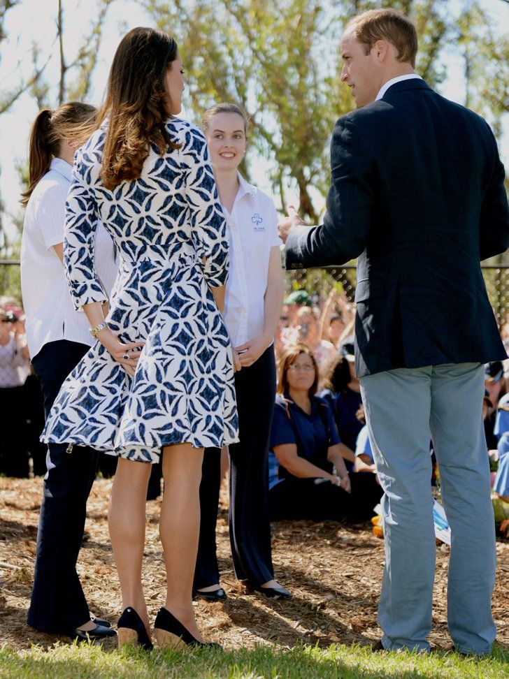 Pin for Later: 9 Times The Duchess of Cambridge's Outfit Was No Match For a Gust of Wind  Kate made sure to keep control of her printed DVF dress as she and William met with young girls during their tour of Australia in April 2014.
