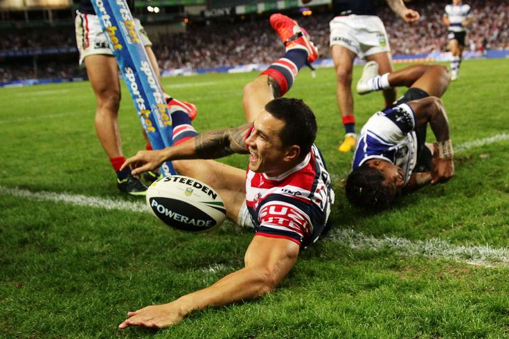 Sonny Bill Williams of the Roosters beats Ben Barba of the Bulldogs to score his first try in the corner during the round six NRL match between the Sydney Roosters and the Canterbury Bulldogs at Allianz Stadium on April 12, 2013 in Sydney, Australia.