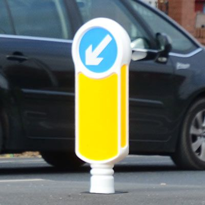 Socketed Rebound Signmaster™ Bollard - Our socketed, rebound keep left bollard has a 300mm signface to alert drivers of junctions and traffic islands. Proven passively safe to BN EN 12767 standard with a quick and easy bollard replacement. #GlasdonUK #Bollard #PassivelySafe #RoadSafety  #HighwaysSafety
