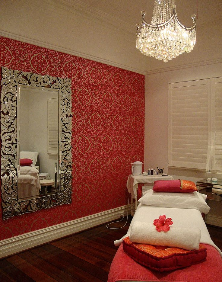 facial room love the wall paper on one side with mirror and chandelier
