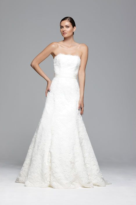Where Love Lives by Stewart Parvin    A strapless corded lace A-line wedding dress with a straight neckline and scalloped hem. Beautiful silk duchess satin covered glove buttons cover the zip at the back.  Stocked by www.paperswanbride.co.nz in Wellington, New Zealand