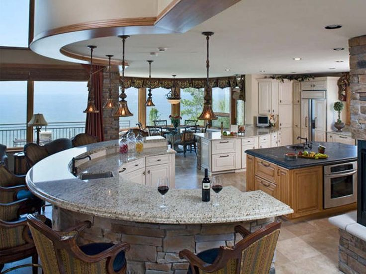 Resplendent Design a Kitchen Island with White Kitchen Cabinets Paint Color also Curved Kitchen Island Designs and Two Level Breakfast Bar with Double Bullnose Granite from Kitchen Island Plans