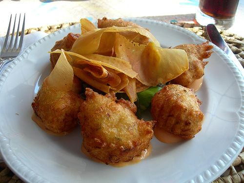 In Barbados we know how to change up things with our food... thinly sliced breadfruit chips and fish cakes with spicy sauce.. humm yummy ... http://on.fb.me/17smUl5