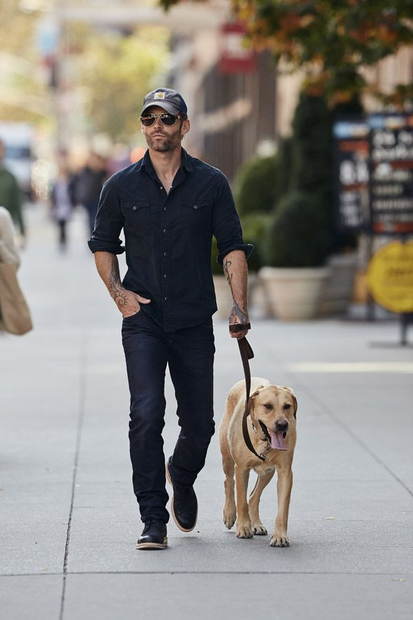 Seann William Scott seen wearing a Carhartt cap while walking his dog in the East Village neighborhood of NYC