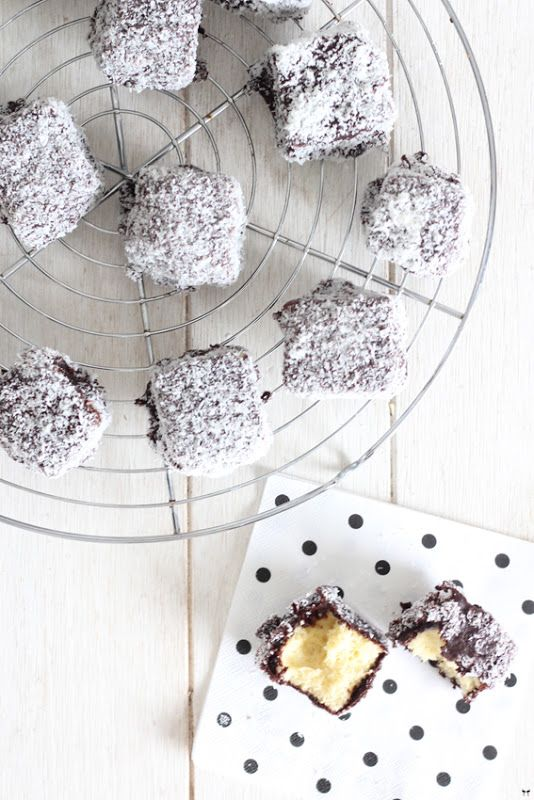 Lamingtons - vanilla cake dipped in chocolate and smothered in coconut! Been wanting to make these for awhile, maybe for our Christmas treats box?