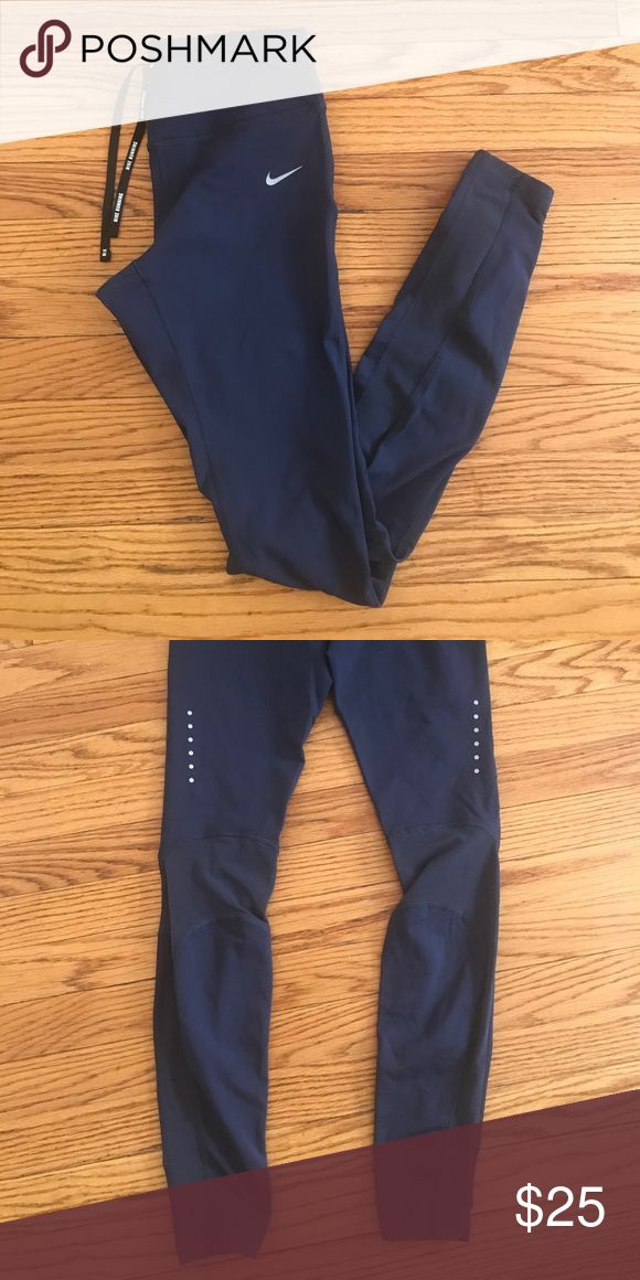 🏃🏽 Nike Running Pants 🇺🇸 Worn once and in perfect condition. Nike navy women's ankle length leggings in a size small. Mesh inserts in back. Smoke and pet free home. Thanks for looking! Nike Pants Leggings