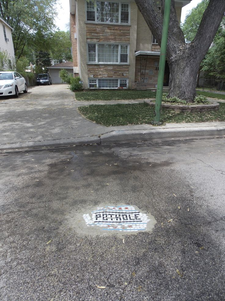 """Jim Bachor is making a functional and artistic statement by filling in potholes on Chicago streets with one-of-a-kind mosaics. Inspired by ancient art styles in Italy, he has filled about seven potholes. He says the mosaics are, """"Meant more as a sense of civic pride than a form of complaint against the city, as the potholes are an inevitable part of living in Chicago.""""  They aren't meant to be a permanent fix, but have surely inspire a lot of smiles around the city this spring!"""