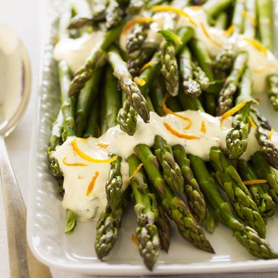 Asparagus with Citrus Sauce Recipe: Low-fat mayonnaise becomes a zingy vegetable sauce with the addition of fresh orange juice, zest, oregano, and a little olive oil. Serve with grilled chicken breast and a side of quinoa for a complete meal. #vegetables #myplate
