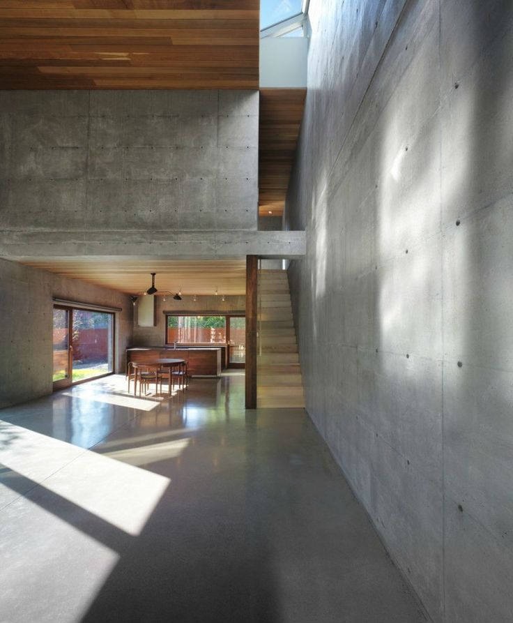 Built in Montreal, Canada, in 2011, this urban residence has exposed concrete walls to the interior and exterior, with insulation in the middle. The vast, light-filled living spaces are designed as a series of framed experiences, whilst retaining a sense of openness throughout. Photography: Marc Cramer