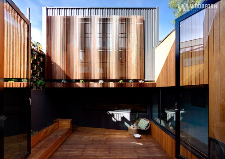 Spotted gum concept click timber battens in exterior residential.