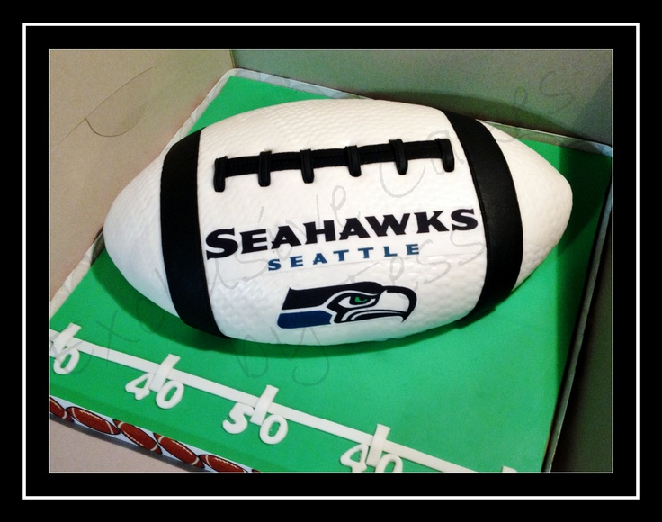 Seattle Seahawks 1/2 football cake by Exclusive Cakes by Tessa