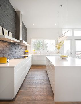 I like the grey backsplash against white cabinets and wood floor. Nice different textures.