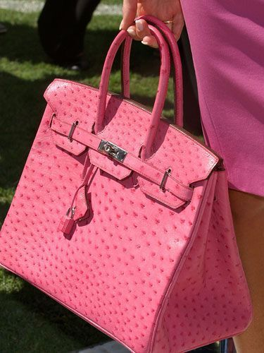 "Victoria Beckham is wearing a bright pink Roland Mouret ""Moon"" dress with a matching ostrich Hermes Birkin bag. Description from pinterest.com. I searched for this on bing.com/images"