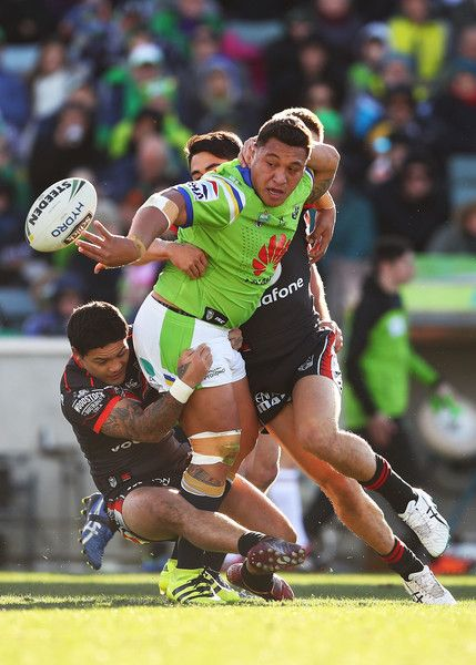 Josh Papalii of the Raiders looks to offload the ball during the round 20 NRL match between the Canberra Raiders and the New Zealand Warriors at GIO Stadium on July 23, 2016 in Canberra, Australia.