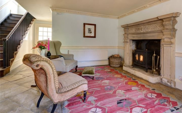 open fire and large rug via savills