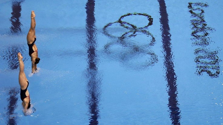 Synchronised divers from team GB attend a training session at the Aquatics Centre