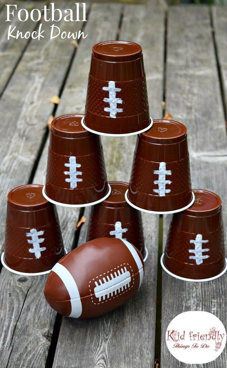 Football knock down game. Football Watch Party Ideas, recipes, and Football Cup Cozies! Crafts, Games, Food and more! Such fun ideas in this post! - http://www.kidfriendlythingstodo.com