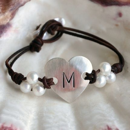 Sterling silver heart with initial is the focal for this modern pearl and leather take on the ID bracelet. The sterling silver heart has been slightly domed and brushed for a soft satin finish.