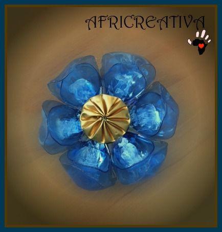 AFRICREATIVA:  fiore realizzati con riciclo bottiglie di plastica e cialde del caffè