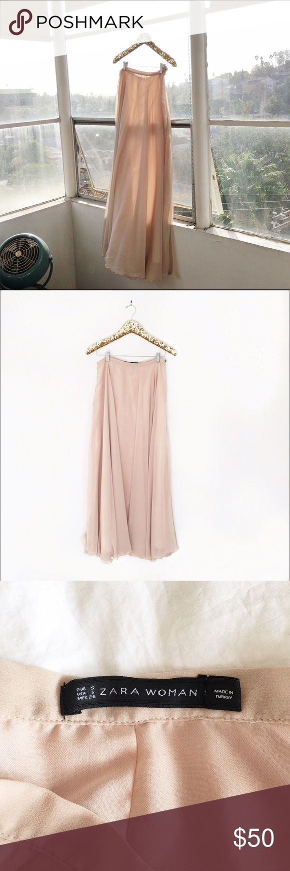 Beautiful Blush Zara Maxi Skirt Blush Zara skirt. Only worn a couple of times.  So beautiful worn with a shirt tucked in or more casual with a denim top. Can really dress up or dress down. Button is a little lose, may need to be reinforced, but other than that, good condition! Zara Skirts Maxi