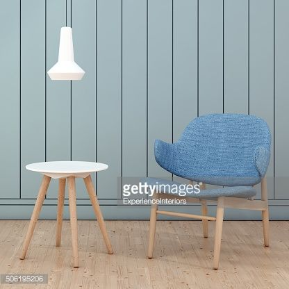 Stock Photo : Blue armchair in front of a wall square close up