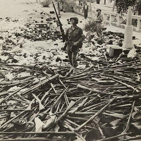 American soldier standing on a large pile of italian weapons on a street in Palermo Italy, on August 6, 1943.  In the pile you can see italian helmets, Carcano rifles and submachine guns. __________________________________  Un soldato americano si erge sopra un'enorme pila di armi italiane catturate in una strada di Palermo, 6 Agosto 1943. Nella pila si possono notare elmetti italiani, fucili Carcano e mitragliatrici. Pin by Paolo Marzioli